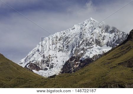 Quitaraju Mountain Peak Located In The Cordillera Blanca Mountain Range, A Part Of The Peruvian Ande