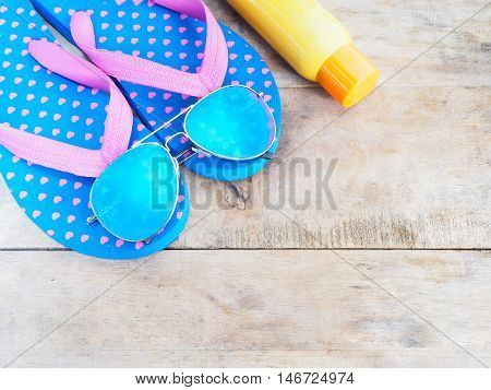 summer beach vacation accessories on wooden background