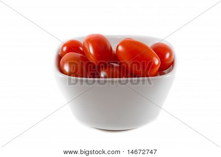 A Bowl Of Red Cherry Tomatoes On An Isolated Background