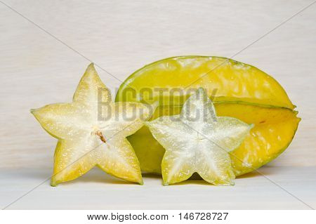 Star Apple Fruit With Half Cross Section Isolated On Wooden Board
