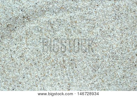 Quartz sand texture full frame top view of sandy background