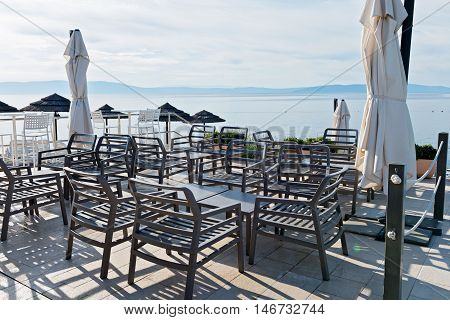 Chairs and tables with beautiful sea view in Istria, Croatian coast