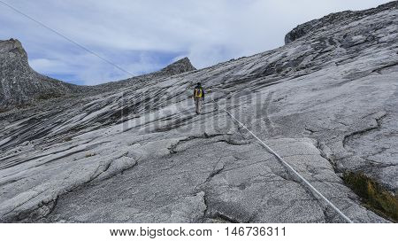 Climbers headed to the Low's Peak (4095m) summit of Mount Kinabalu Sabah Malaysia. Mount Kinabalu or Gunung Kinabalu is the 20th most prominent mountain in the world by topographic prominence.
