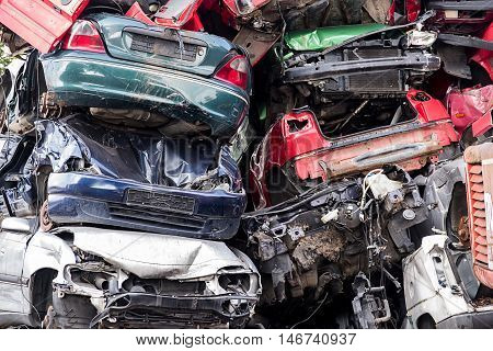 pile of discarded scrap car on a junkyard concept for insurance or waste management