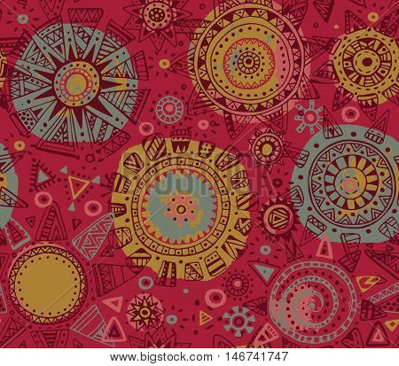 Vector seamless pattern with graphic doodle suns, stars and tribal elements. Hand drawn endless background in red, yellow, green colors with many details and watercolor texture. Modern textile design
