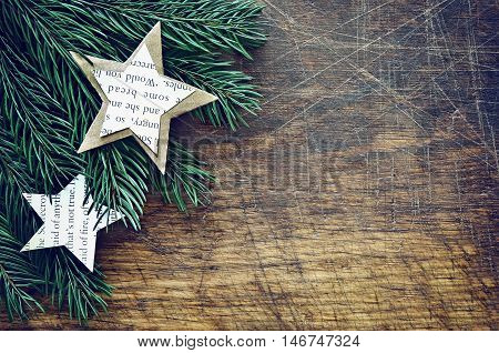 Christmas retro background with firry branches decorated with handmade paper decorations stylized image