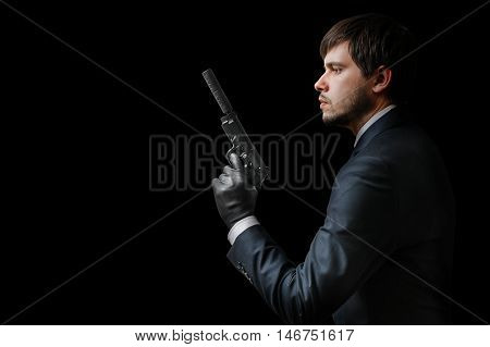 Murderer Or Assassin Holding Pistol With Silencer. Mafia And Cri