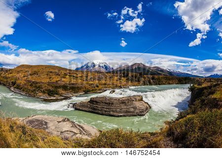 Chile, Patagonia, Torres del Paine National Park - Biosphere Reserve. Cascades Paine. Cold emerald water of the river Paine with a roar there pass rocky barriers