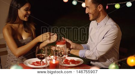 Romantic young man presenting a Valentines gift