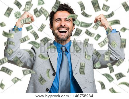 Successful businessman enjoying a rain of money