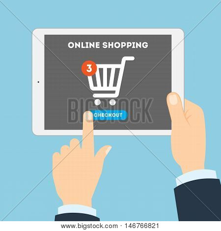 Online shopping concept. Buying products and service through Internet using tablet. Shopping cart with checkout button.