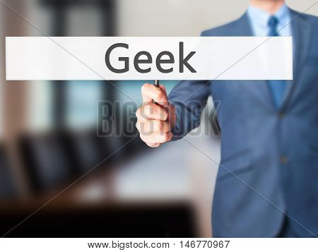 Geek - Businessman Hand Holding Sign