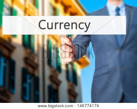 Currency - Businessman Hand Holding Sign