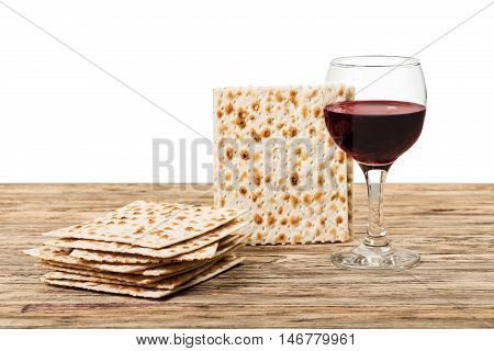 passover background. wine and matzoh (jewish passover bread)  over wooden background. vintage effect process