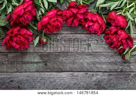 Pink Peonies Flowers On Rustic Wooden Background. Selective Focus, Place For Text, Top View