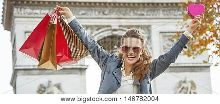Smiling Fashion-monger With Shopping Bags In Paris Rejoicing