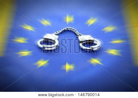 European Union flag and handcuffs European Union law concept.