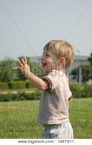 Boy Waving Excitedly