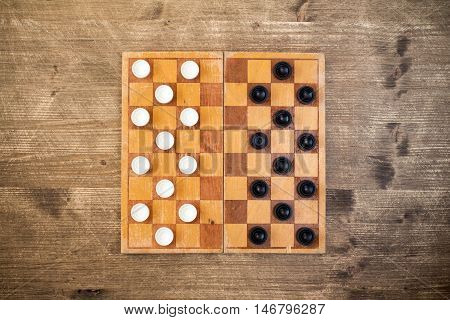 Top view of draughts checkers board game