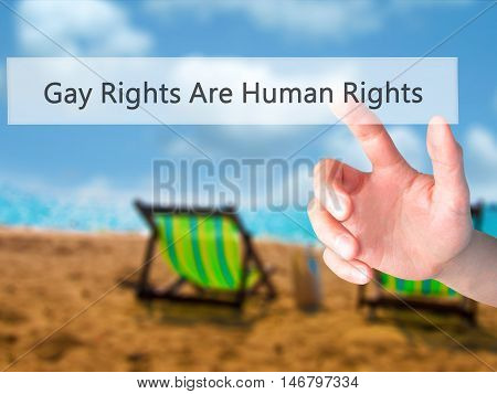 Gay Rights Are Human Rights - Hand Pressing A Button On Blurred Background Concept On Visual Screen.