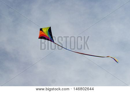 colorful kite flying on a clear blue autumn sky