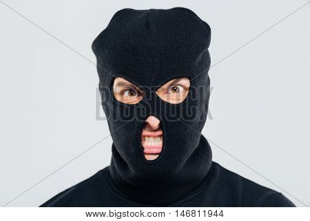 Closeup of angry aggressive young man in balaclava