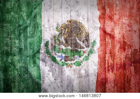 Grunge Style Of Mexico Flag On A Brick Wall