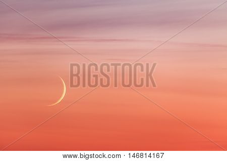 New moon crescent and pastel colors sunset beautiful sky background