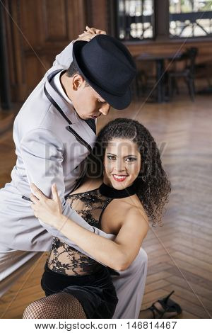 Woman Smiling While Performing Tango With Man