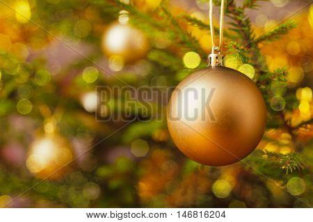 Christmas celebration holiday background - christmas-tree decoration bauble on decorated Christmas tree with defocused blurred lights bokeh and copyspalce