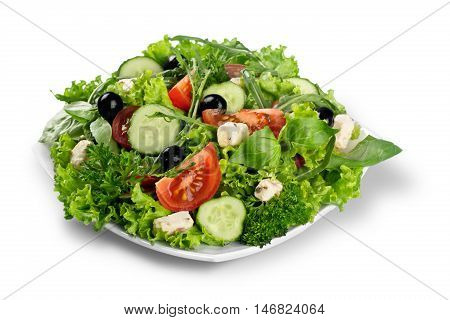 Individual side serving of delicious fresh Greek salad with feta cheese, olives, tomatoes and salad greens