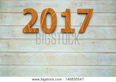 Three-dimensional rendering of wooden 2017 on the wooden background represents the new year 2017 3D illustration