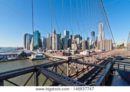 New York City USA - November 18 2011: Traffic on the Brooklyn Bridge with the Lower Manhattan skyline in the background.