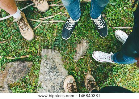 Hiking Shoes On Hiker Outdoors Walking Crossing River Creek. Woman  And Men On Hike Trekking In Natu