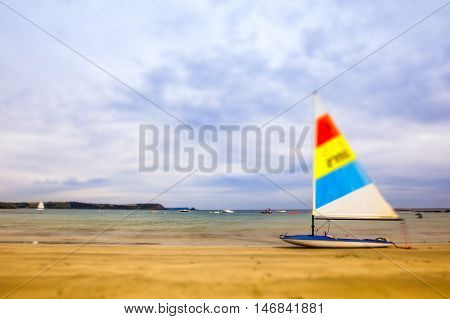 Sail boat on the beach tilt and shift
