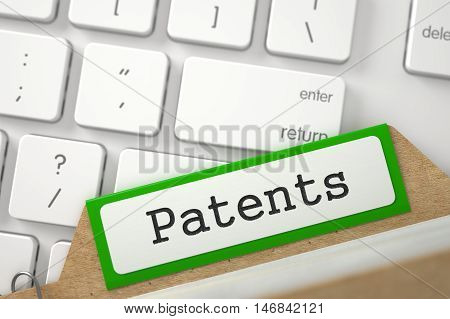 Patents written on Green Card Index on Background of Modern Keyboard. Closeup View. Selective Focus. 3D Rendering.
