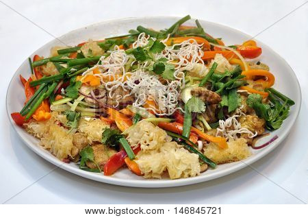 salad with vegetables and meat closeup isolated on the white