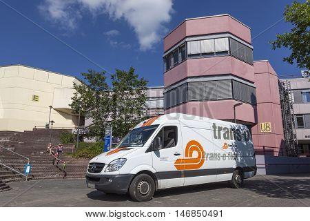 SIEGEN GERMANY - SEP 8 2016: Trans-o-flex delivery van at the university of Siegen campus. North Rhine Westphalia Germany