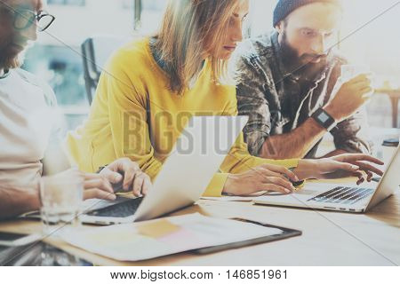 Group Young Coworkers Team Work Office Studio.Account Manager Showing New Business Idea Startup Presentation.Woman Typing Modern Laptop.Desktop Computer Wood Table.Blurred, Film Effect.Horizontal