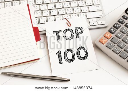 Word text Top 100 on white paper card on office table / business concept