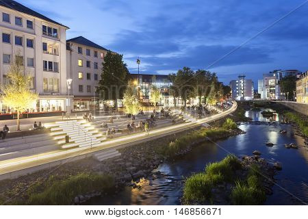 SIEGEN GERMANY - SEP 1 2016: New waterfront promenade at the Sieg river in the city of Siegen at night. North Rhine Westphalia Germany