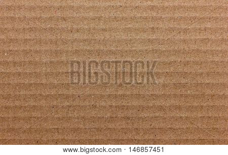 Texture of cardboard light brown color for design.