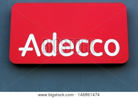 Fredericia, Denmark - September 10, 2016: Adecco logo on a wall. Adecco Group, based near Zurich, Switzerland, is the largest staffing firm in the world