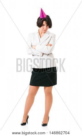 Full length portrait of a young businesswoman in birthday cap, isolated white background. Hen party or birthday celebration. Woman with party hats posing with  folded arms.
