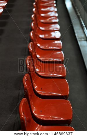 Clean red tribune seats in sport hall