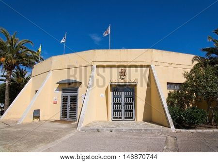 Poblense Entrance Building With Flags