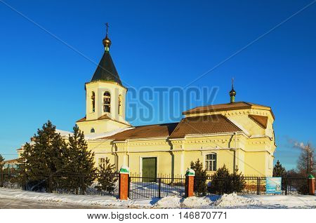 NIZHNY TAGIL RUSSIA - FEBRUARY 13 2016: Church in the name of St. Nicholas the Wonderworker winter morning in the rays of the rising sun