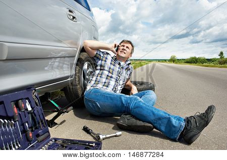 Man With Phone Is Calling In Service Of Car