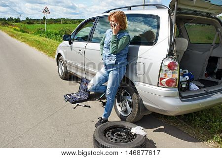 Woman With Phone Is Calling In Service Of Car