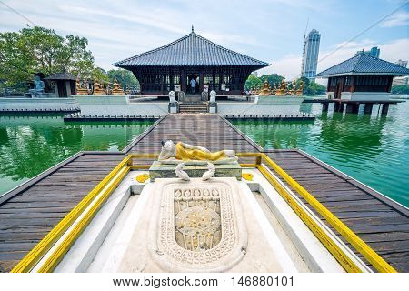 COLOMBO SRI LANKA - FEBRUARY 16 2016: Seema Malaka Temple in Colombo is situated on Beira Lake and is part of the Gangaramaya Buddhist Temple Complex